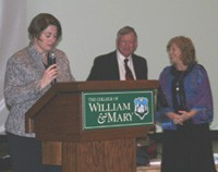 Patty Roberts Clinical Director of Programs at W&M Law School presents Pete and Pam Wright with Wrightslaw Army logo