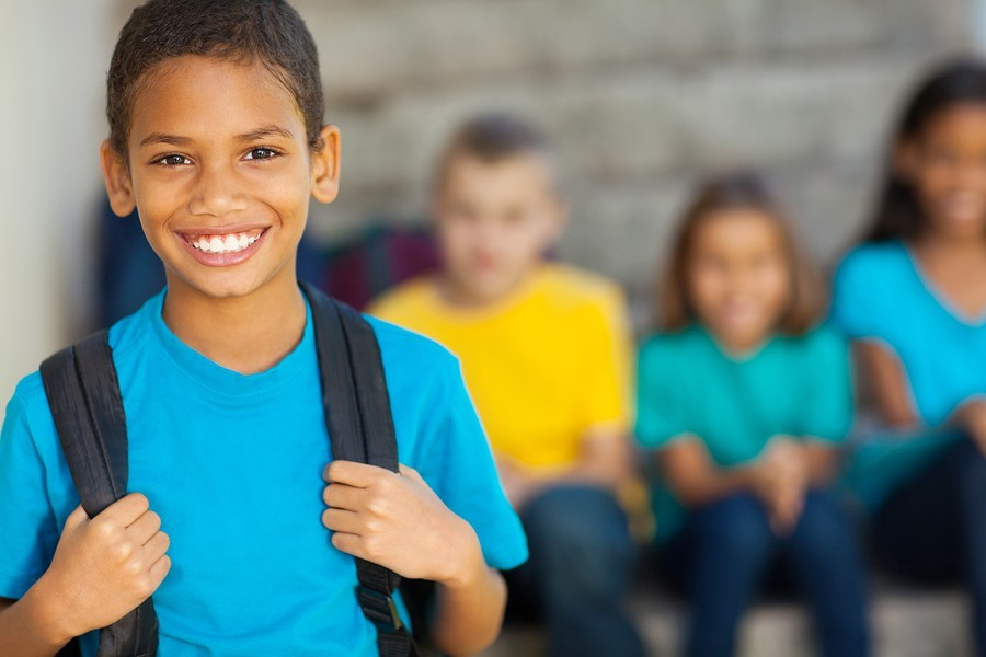 image of boy with backpack at school