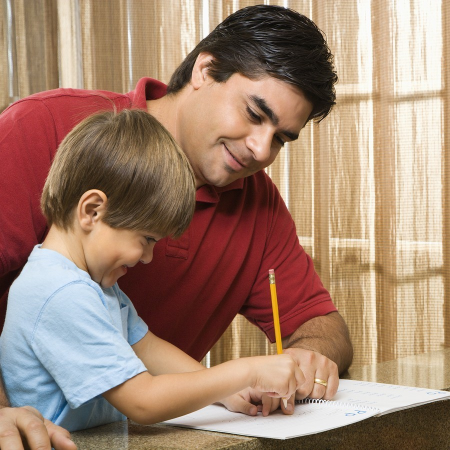dad and boy do school work