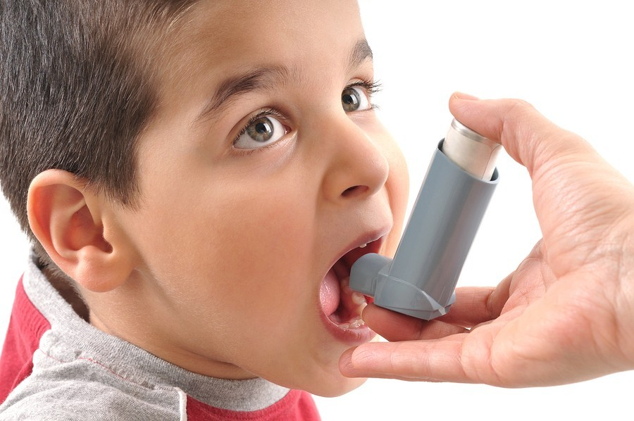 sick boy with inhaler