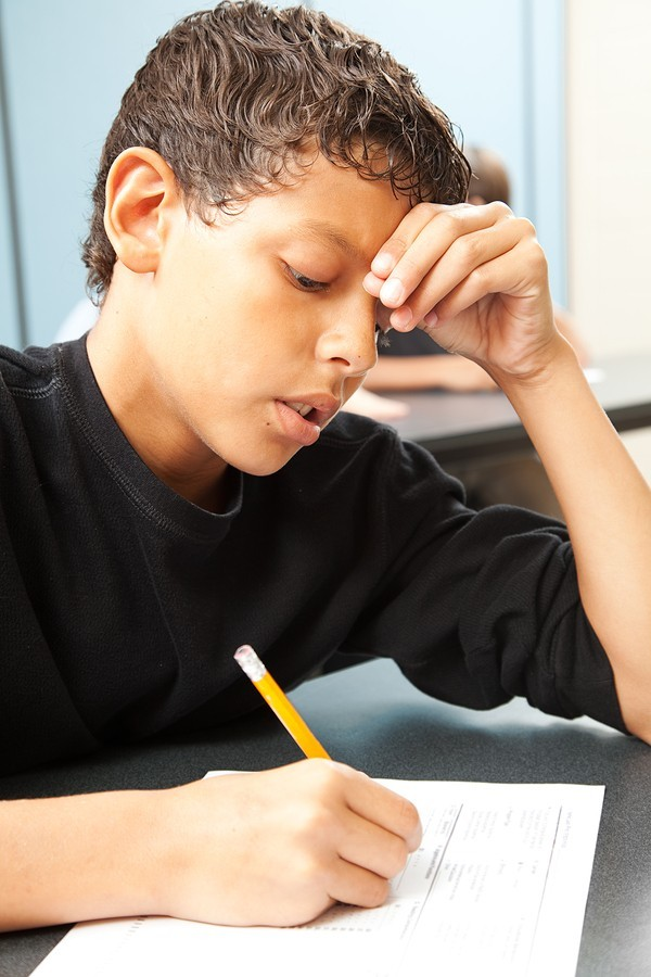 boy struggling with assignments
