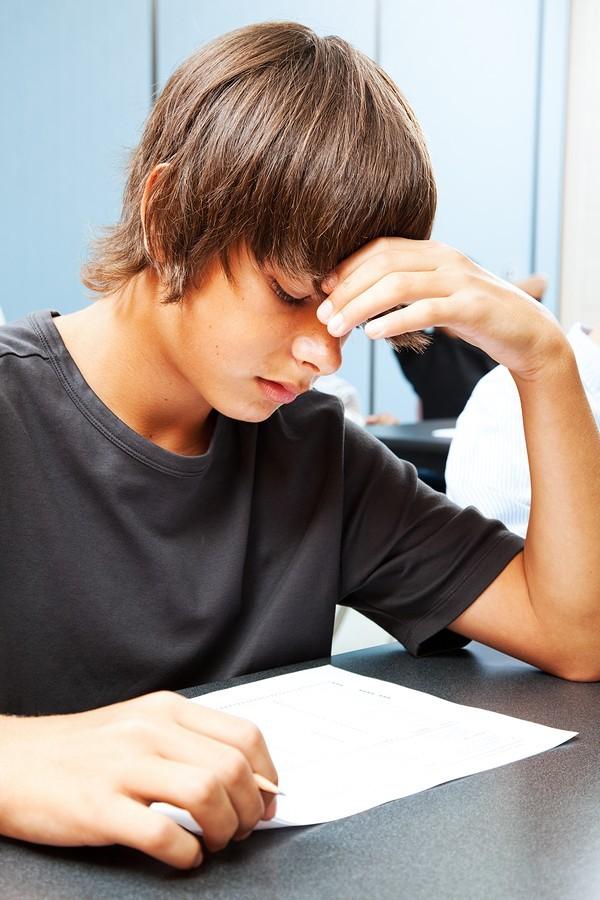boy student taking test
