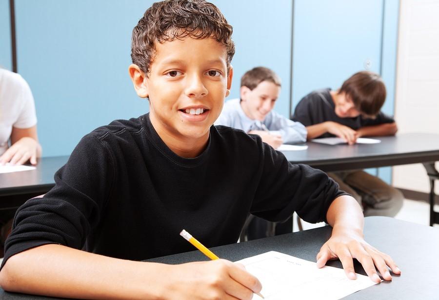 boy taking test in classroom