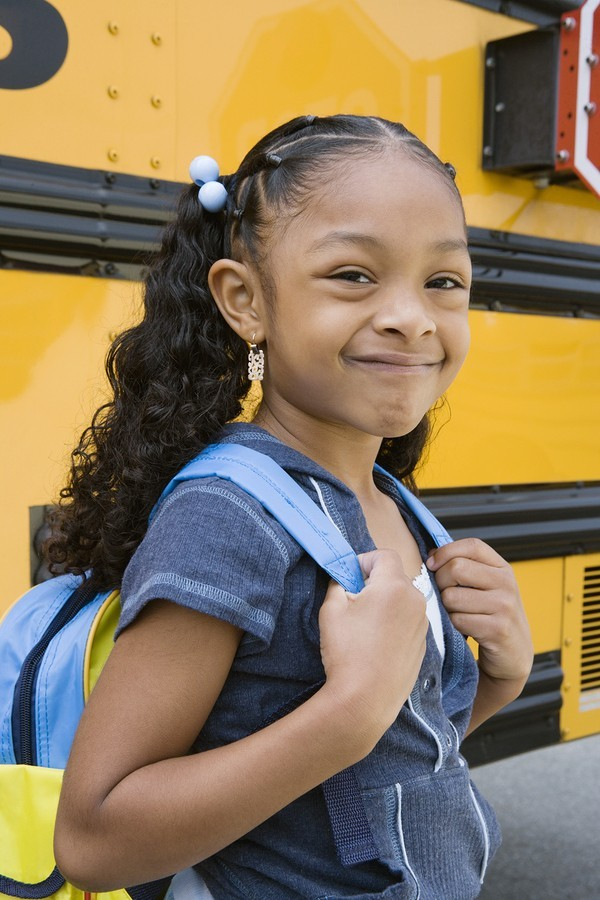 girl student getting on school bus