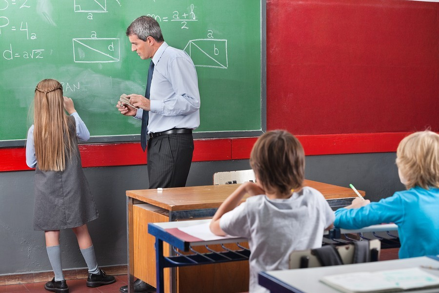 image of teacher and student at math blackboard