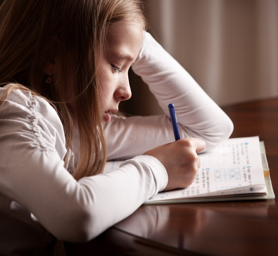girl struggling with school work