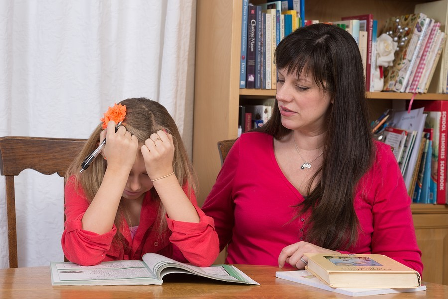 frustrated girl student with teacher in schoolwith