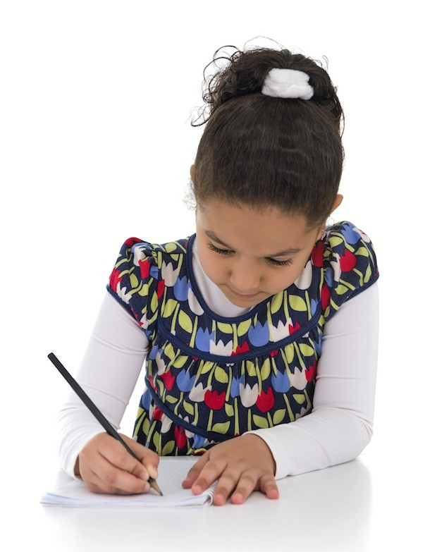 image of young girl writing in school
