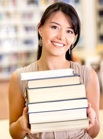 happy lady with heavy load of books