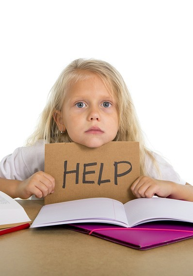 image of young girl student with sign that says help width=