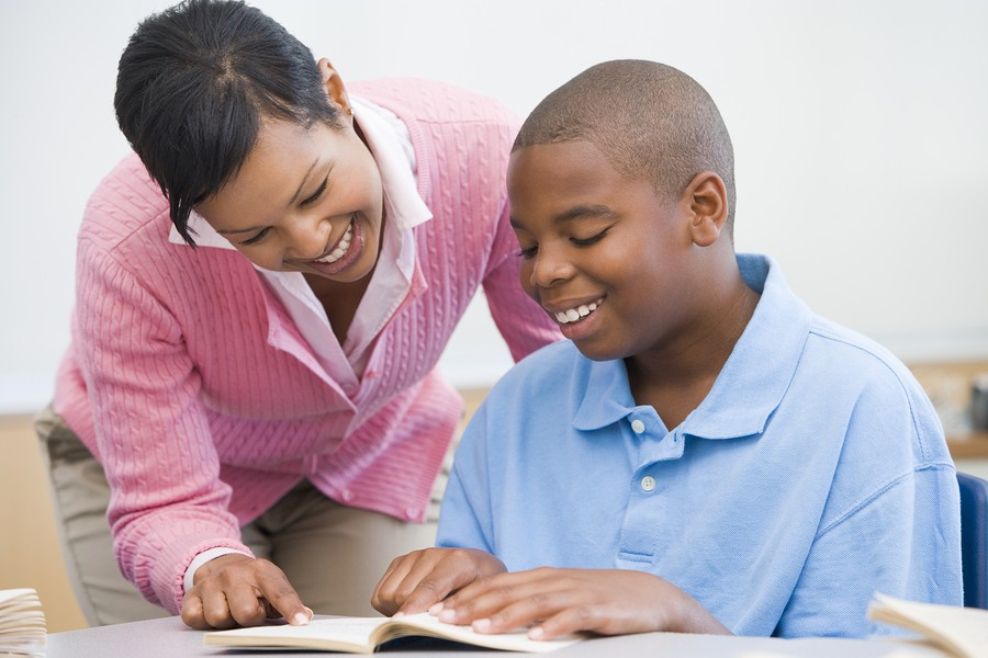 image of high school boy reads with mother