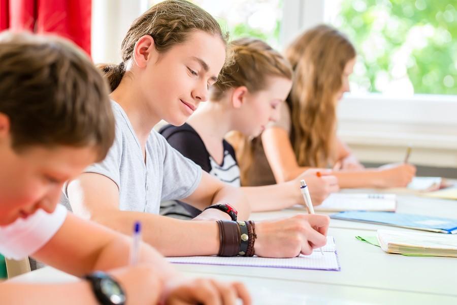 teacher giving boy a reading test