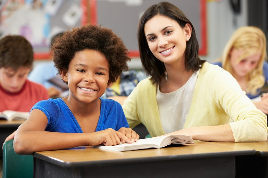 teacher and girl with book