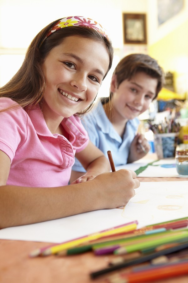 preteen students working at school