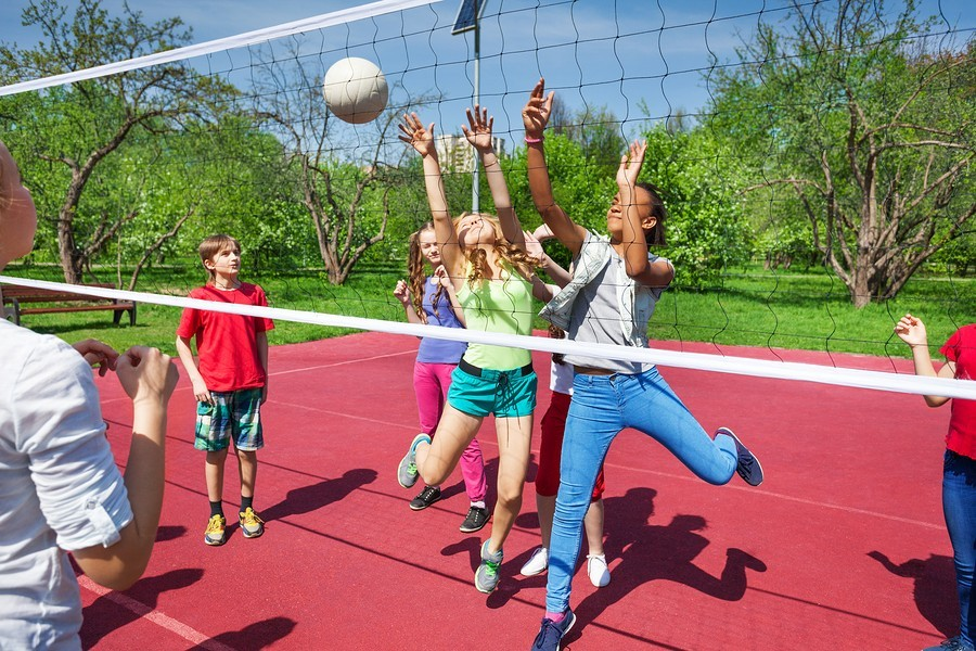 kids playing volleyball at recess