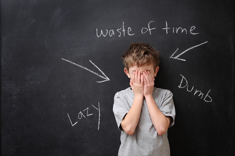 frustrated boy at blackboard