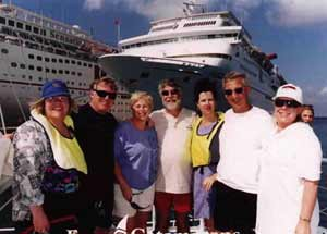 group of people standing in front of cruise ship