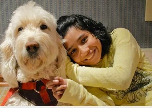 Ehlena Fry and her service dog Wonder