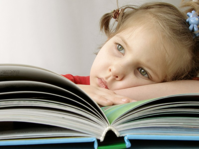 young girl trying to read