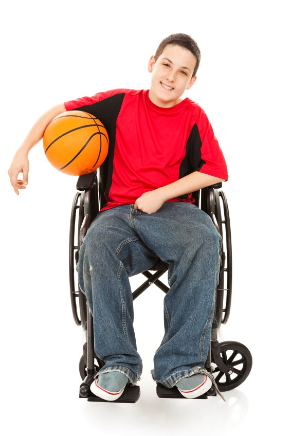student with basketball in a wheelchair