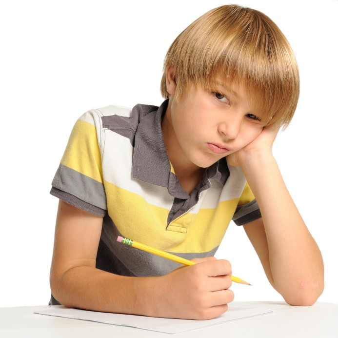 image of boy at school looking frustrated