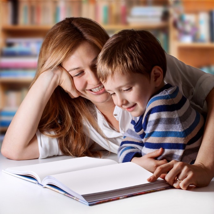 young boy and mother reading