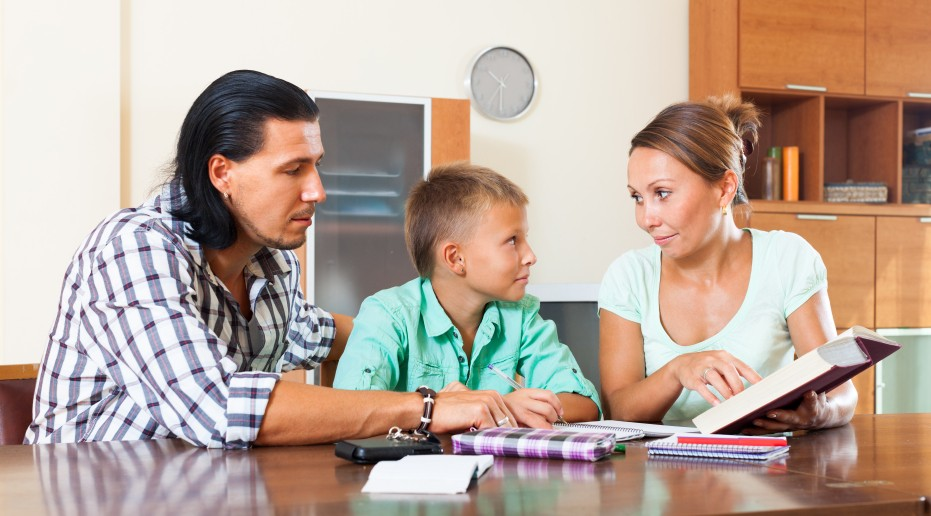 parents helping boy with homework