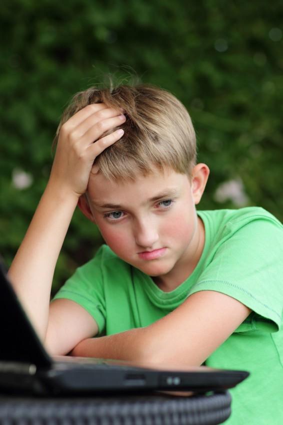 concerned school boy at computer