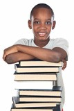 school boy with stack of books