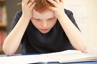 boy stressed doing homework