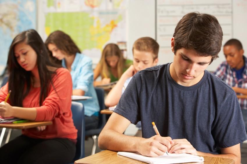 teen boy in class at school