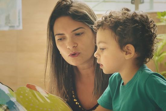 mom teaching young boy