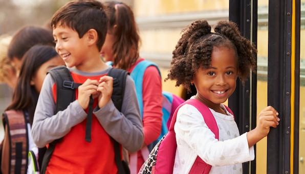 Children prepare to board the school bus