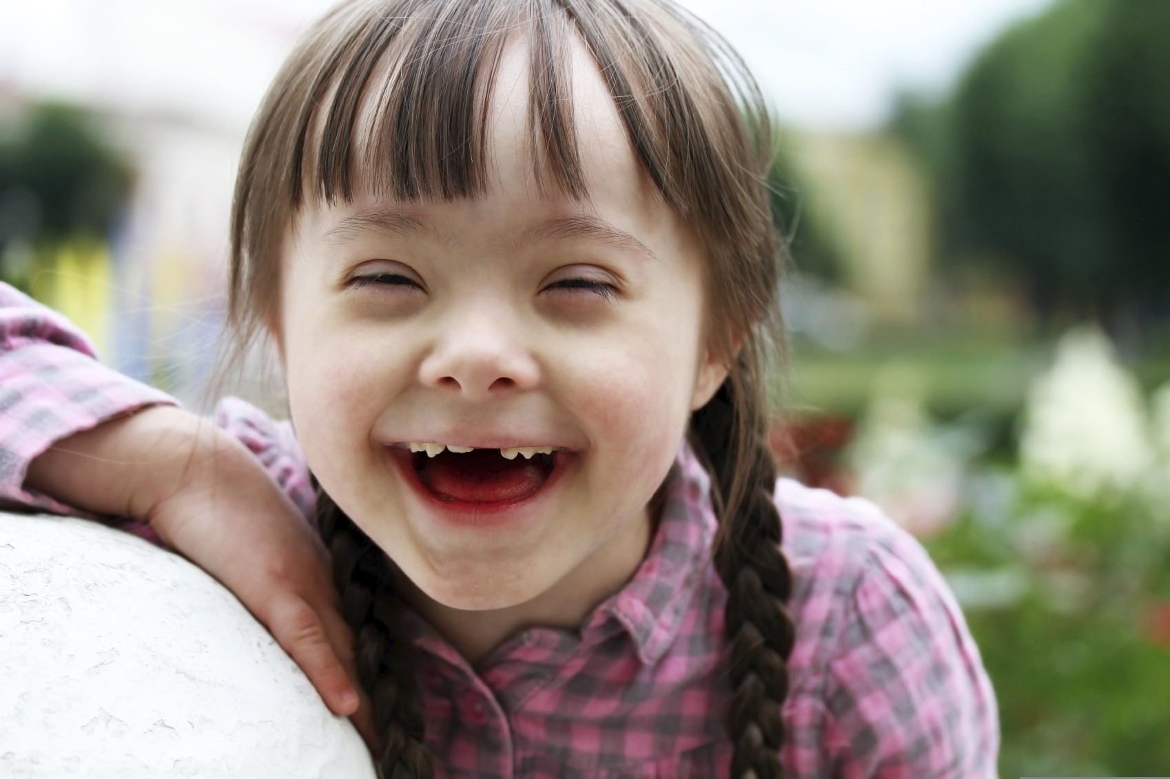 Young child with Down syndrome laughing