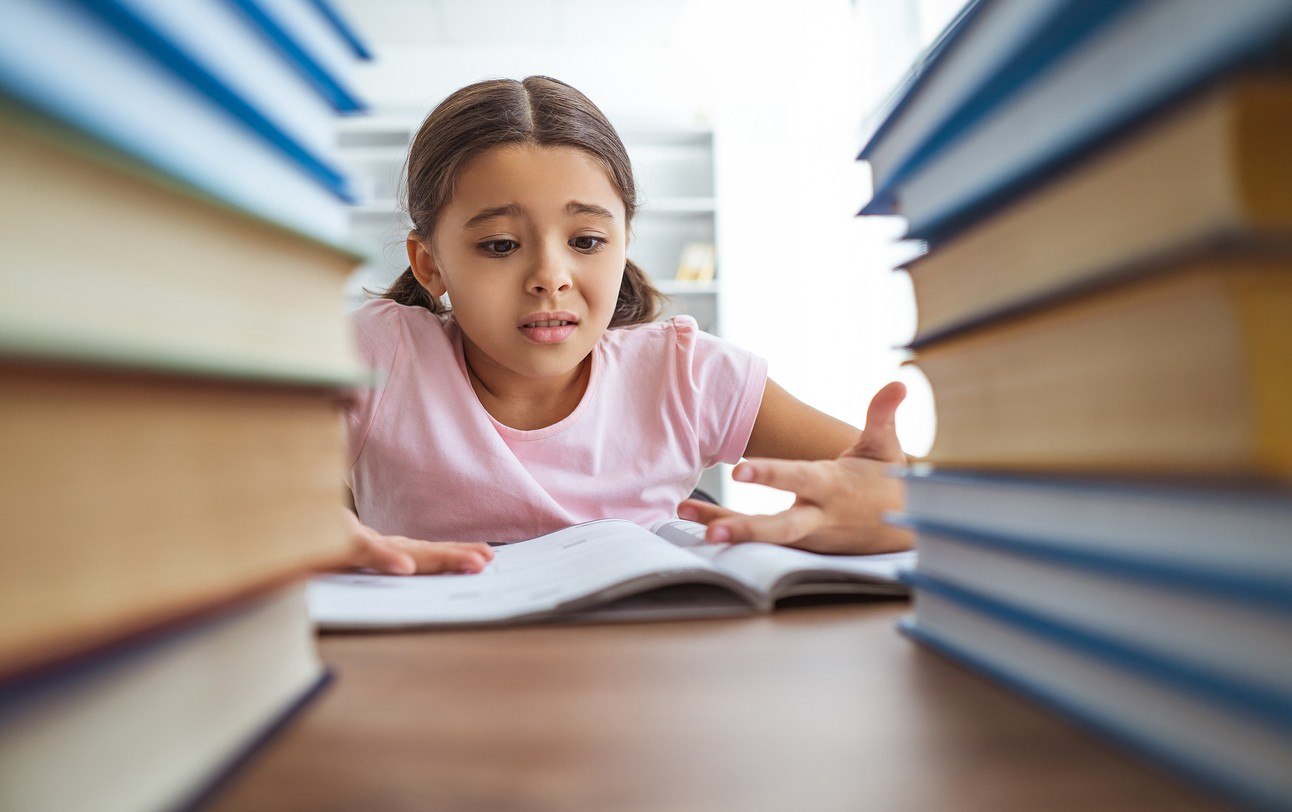 image of girl student working in class