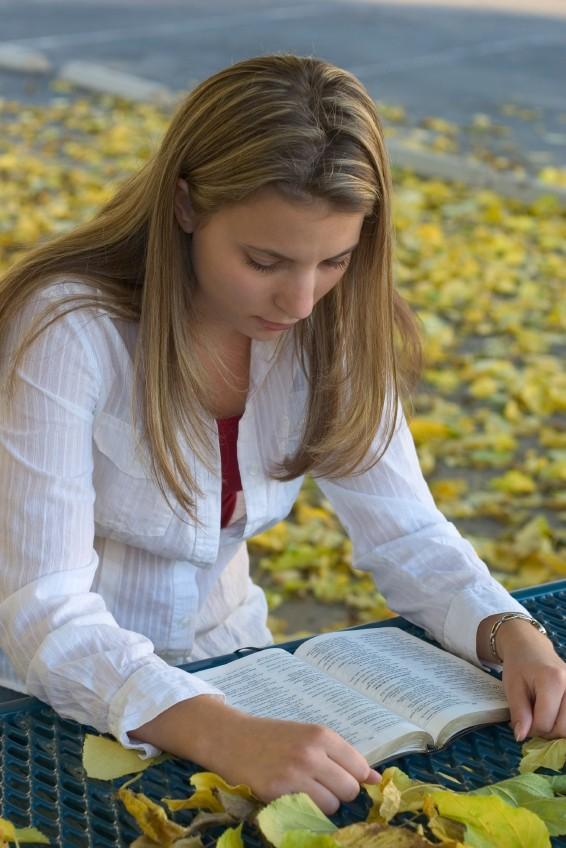 girl teen reading outside