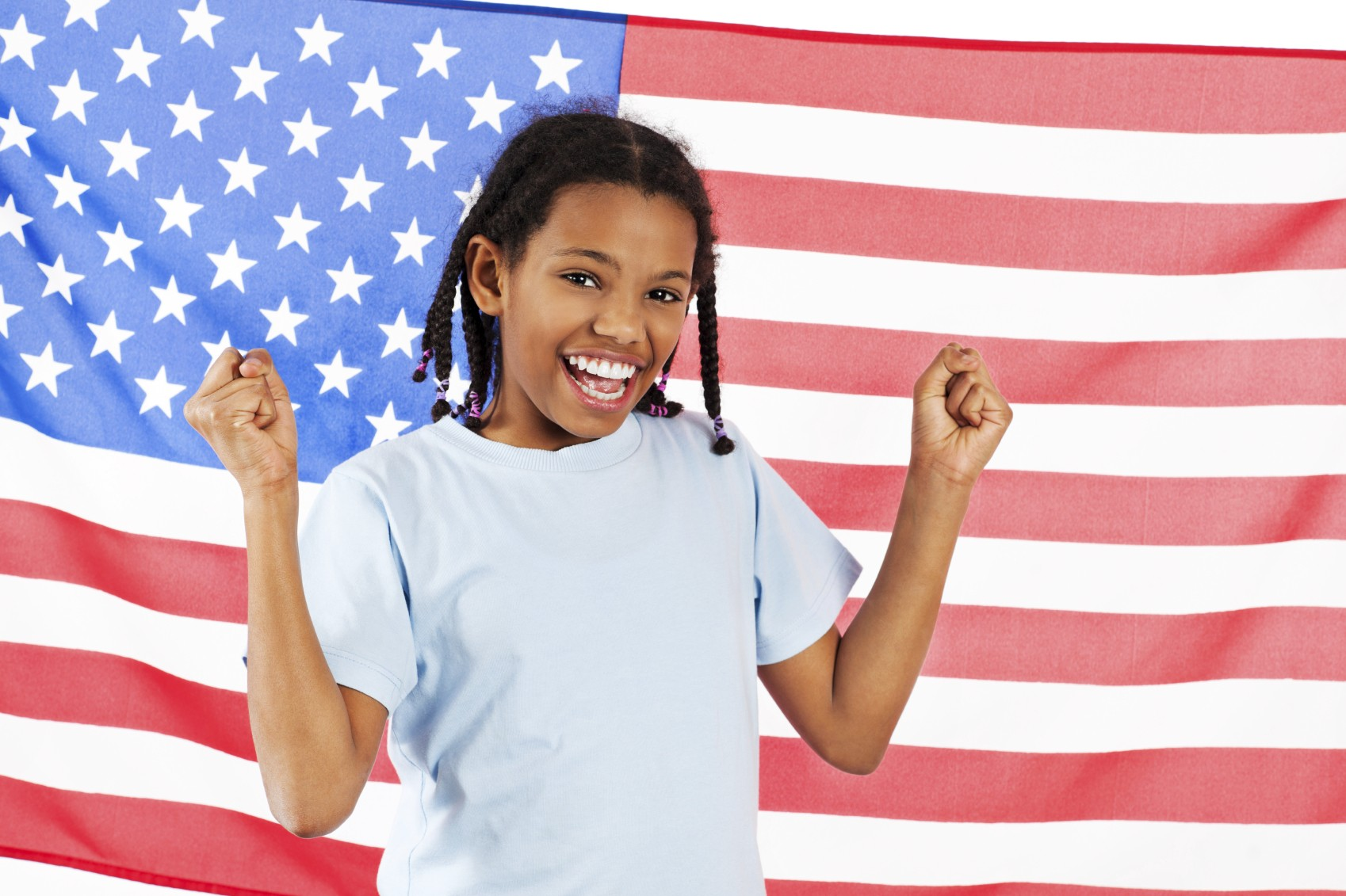 teen girl in front of US flag
