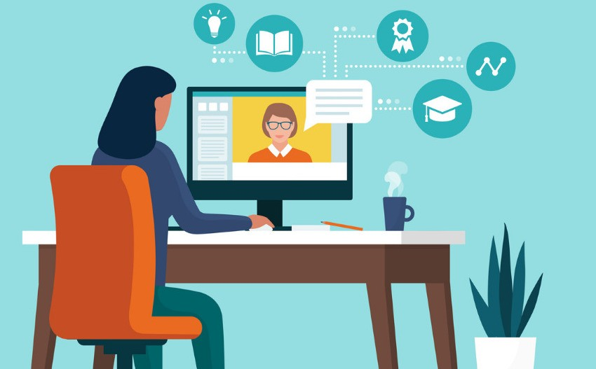 woman sitting at computer participating in a virtual IEP meeting