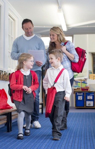 image of parents and kids in hallway at school