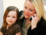 parent advocate mom on phone and daughter