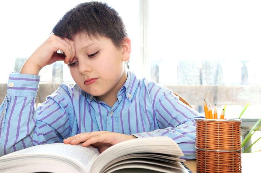 boy reading in class