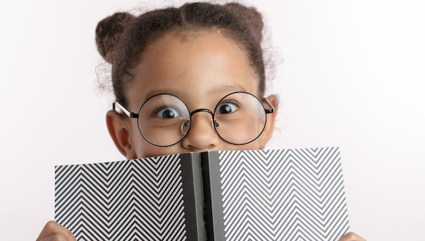 young girl excited about learning to read