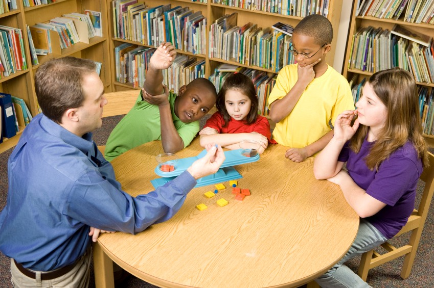 students and teacher in library