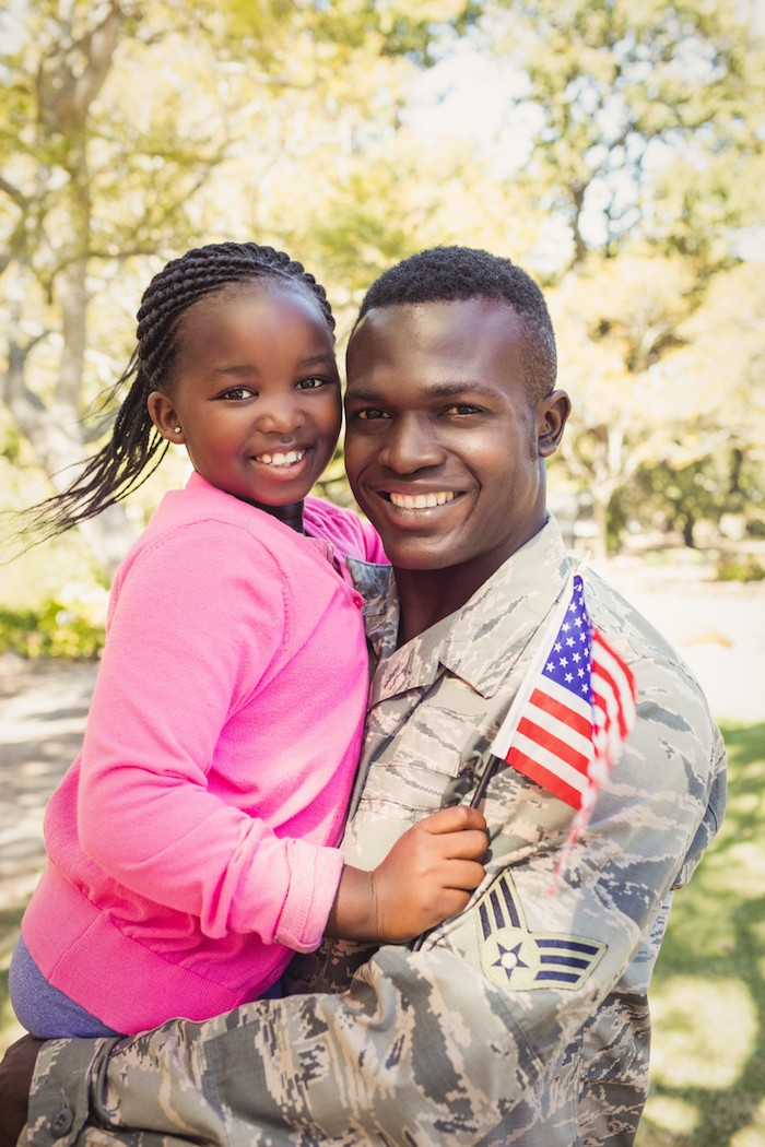 image of soldier dad with daughter