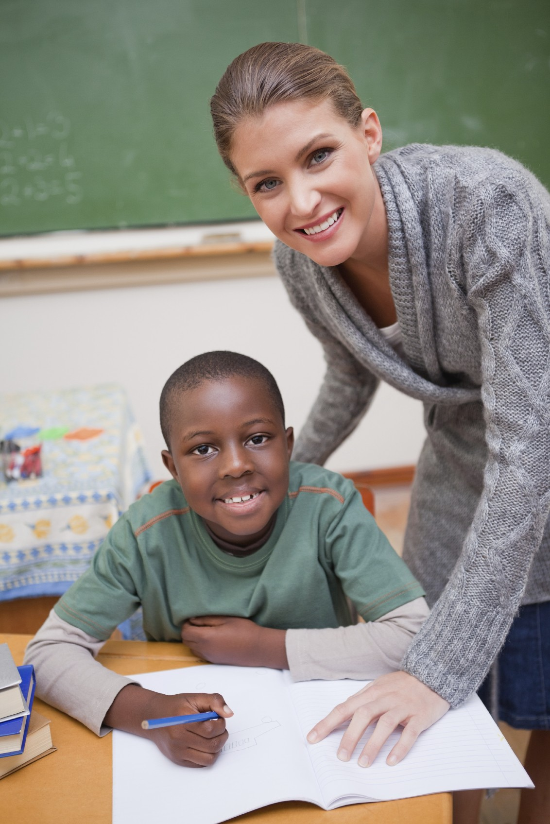 image of teacher and boy in classroom