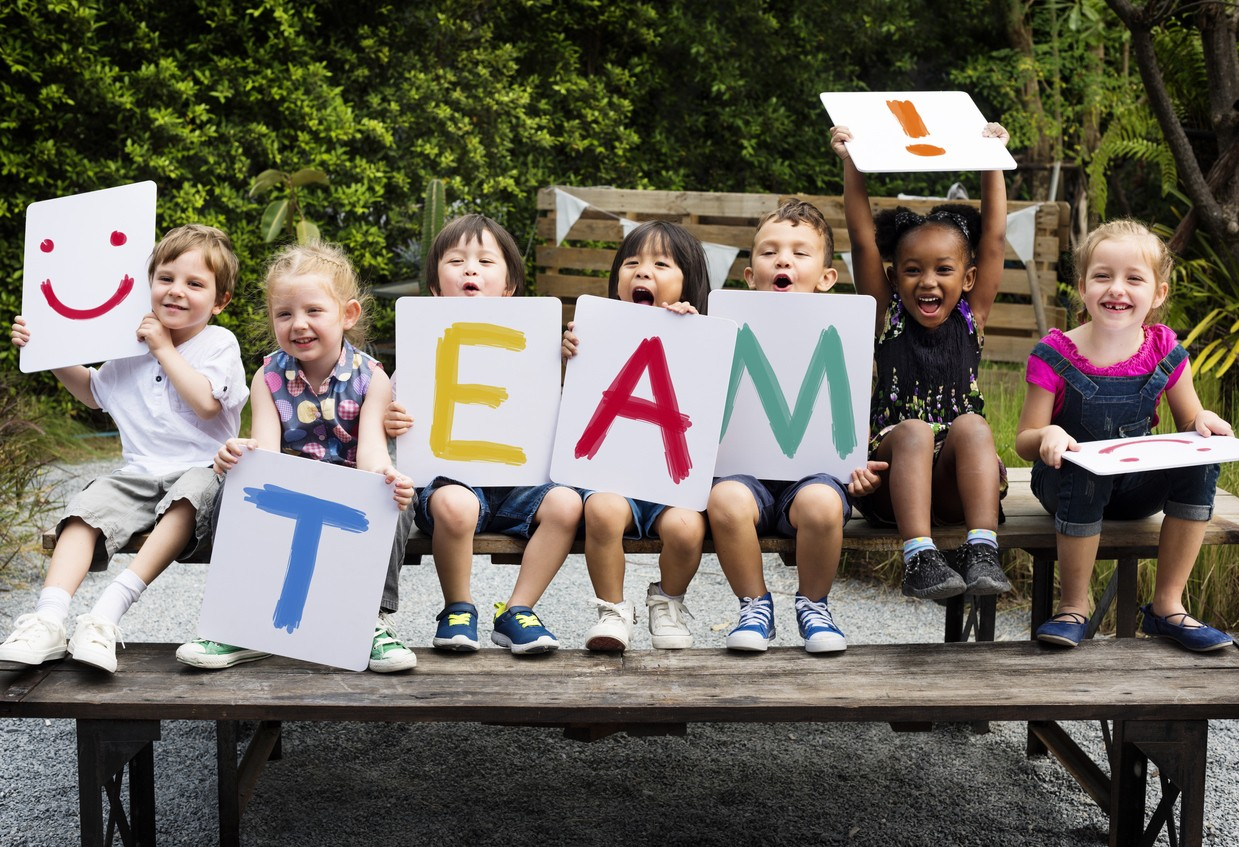 image of school kids with team sign