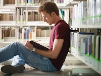 teen in library
