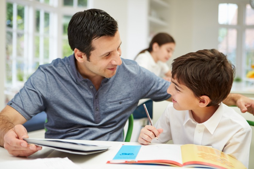 paraprofessional aide and student boy