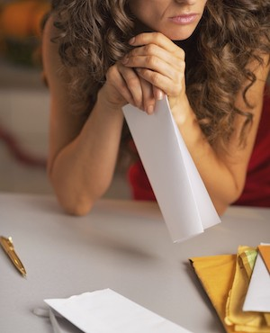 woman reading sad letter