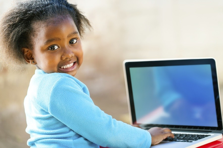young girl in school on computer